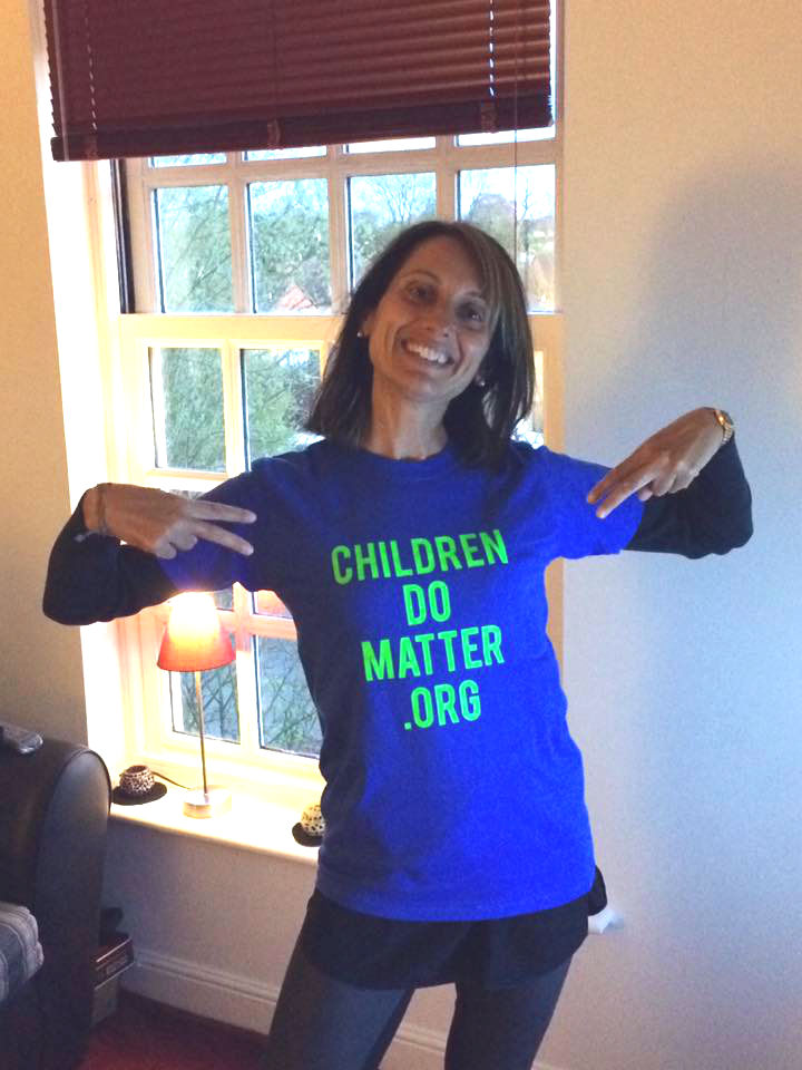 rossella wearing the children do matter t-shirt